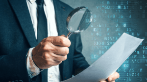Information Security Officer examine paper using Magnify Glass
